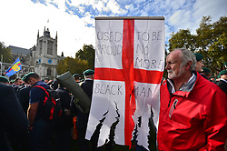 © Licensed to London News Pictures. 28/10/2015. London, UK. Former leader of the EDL, TOMMY ROBINSON (left) at the demo. Former and serving members of the armed forces take part in a rally in support of support of Sgt Alexander Blackman, who was given a life sentence after being convicted of murdering a wounded Taliban fighter. Senior military officials have warned of possible disciplinary action against troops caught attending the event. Photo credit: Ben Cawthra/LNP