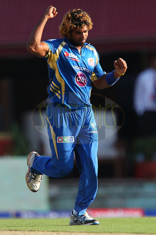 Lasith malinga celebrates the wicket of Praveen Kumar (his 100th IPL wicket) during match 69 of the Pepsi Indian Premier League between The Kings XI Punjab and the Mumbai Indians held at the HPCA Stadium in Dharamsala, Himachal Pradesh, India on the on the 18th May 2013..Photo by Ron Gaunt-IPL-SPORTZPICS ..Use of this image is subject to the terms and conditions as outlined by the BCCI. These terms can be found by following this link:..http://www.sportzpics.co.za/image/I0000SoRagM2cIEc