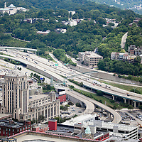 An aerial view of Cincinnati Ohio expressways, buildings, and trees. Photo is high resolution.