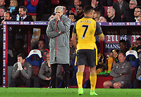Football - 2016 / 2017 Premier League - Crystal Palace vs. Arsenal<br /> <br /> A dejected Arsenal Manager Arsene Wenger glances over at Alexis Sanchez at Selhurst Park.<br /> <br /> COLORSPORT/ANDREW COWIE