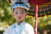 You boy dressed as girl for Buddhist initiation ceremony. Bagan, Myanmar.