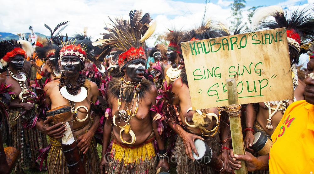 Women from the Kaubaro Siane tribal group wearing traditional dress and dancing at the Goroka festival Papua New Guinea.