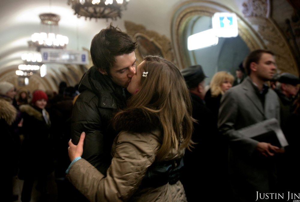 A couple kisses inside the Kievskaya metro station. .The Moscow Metro, which spans almost the entire Russian capital, is the world's second most heavily used metro system after the Tokyo's twin subway. Opened in 1935, it is well known for the ornate design of many of its stations, which contain outstanding examples of socialist realist art.