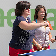 August 16, 2014, New Haven, CT:<br /> Fans play ping pong during a tennis clinic in the AETNA FitZone as part of Kids Day on day three of the 2014 Connecticut Open at the Yale University Tennis Center in New Haven, Connecticut Sunday, August 17, 2014.<br /> (Photo by Billie Weiss/Connecticut Open)