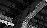 Black and white of the underside of a road bridge in Franklin, North Carolina.