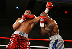 July 27, 2007; Saratoga Springs, NY, USA; Chazz Witherspoon (Red Trunks), nephew of former heavyweight champion Tim Witherspoon, knocks out Talmadge Griffis (Grey Trunks) in the 9th round of their 10 round heavyweight bout at the Saratoga Springs City Center.