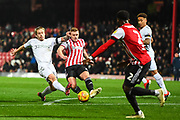 Middlesbrough Midfielder Adam Clayton (8) and Brentford Midfielder Lewis Macleod (4) battle for the ball during the EFL Sky Bet Championship match between Brentford and Middlesbrough at Griffin Park, London, England on 24 November 2018.