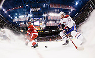 Nov 16, 2014; Detroit, MI, USA; Detroit Red Wings left wing Drew Miller (20) and Montreal Canadiens center Alex Galchenyuk (27) battle for the puck in the first period at Joe Louis Arena. Mandatory Credit: Rick Osentoski-USA TODAY Sports