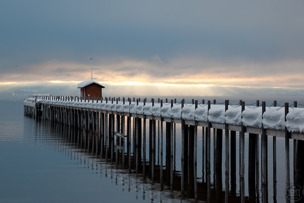 """Snowy Pier in Tahoe City 2"" - This snow covered pier and two flying birds were photographed in the early morning near Commons Beach in Tahoe City, CA."