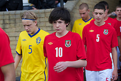 FLINT, WALES - Thursday, May 12, 2011: Wales' Callum Saunders walks out to face Sweden during the Men's Under-17's International Friendly match at Cae-y-Castell. (Photo by David Rawcliffe/Propaganda)