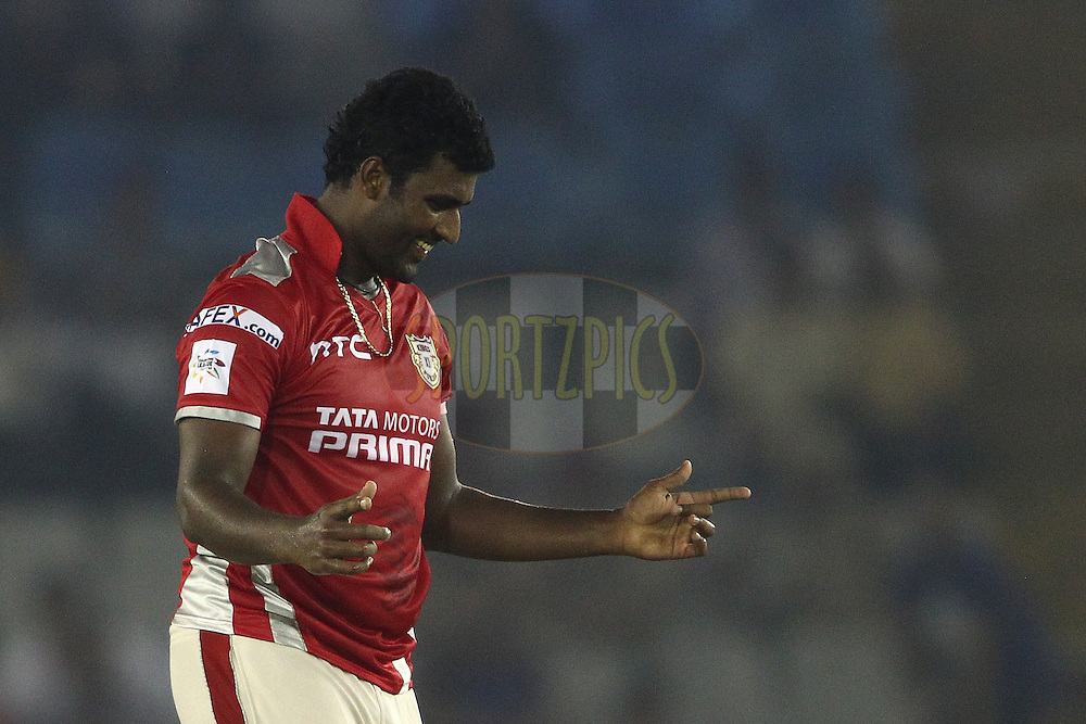 Thisara Perera of the Kings XI Punjab celebrates getting Aiden Blizzard of the Hobart Hurricanes wicket during match 2 of the Oppo Champions League Twenty20 between the Kings XI Punjab and the Hobart Hurricanes held at the Punjab Cricket Association Stadium, Mohali, India on the 18th September 2014<br /> <br /> Photo by:  Shaun Roy / Sportzpics/ CLT20<br /> <br /> <br /> Image use is subject to the terms and conditions as laid out by the BCCI/ CLT20.  The terms and conditions can be downloaded here:<br /> <br /> http://sportzpics.photoshelter.com/gallery/CLT20-Image-Terms-and-Conditions-2014/G0000IfNJn535VPU/C0000QhhKadWcjYs
