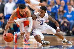 Kentucky guard Tyler Ulis, right, extends for a steal against Florida guard Chris Chiozza in the first half.<br /> <br /> The University of Kentucky hosted the University of Florida, Saturday, Feb. 06, 2016 at Rupp Arena in Lexington .