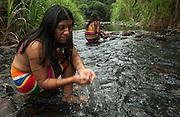 Colorado Indian women Bathing - Melina & Sonia Calazacón<br /> Tierra de Tsachila Comuna Chihuilpe<br /> Santo Domingo de Los Colorados<br /> ECUADOR, South America