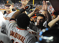 Apr. 17 2011; Phoenix, AZ, USA; San Francisco Giants batter Pablo Sandoval (48) is congratulated by teammates after hitting a home run during the sixth inning against the Arizona Diamondbacks at Chase Field. Mandatory Credit: Jennifer Stewart-US PRESSWIRE..