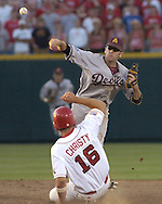 Arizona State second basemen Seth Dhaenens forces out Nebraska's Jeff Christy (16) at second base, as he throws to first to complete the double play.  Nebraska defeated Arizona State in the first round of the College World Series 5-3 at Rosenblatt Stadium in Omaha, Nebraska on June 17, 2005.