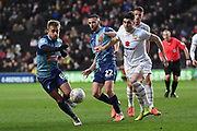 Wycombe Wanderers midfielder Alex Pattison (8) battles for possession  under pressure from Milton Keynes Dons defender Jordan Moore-Taylor (15) during the EFL Sky Bet League 1 match between Milton Keynes Dons and Wycombe Wanderers at stadium:mk, Milton Keynes, England on 1 February 2020.