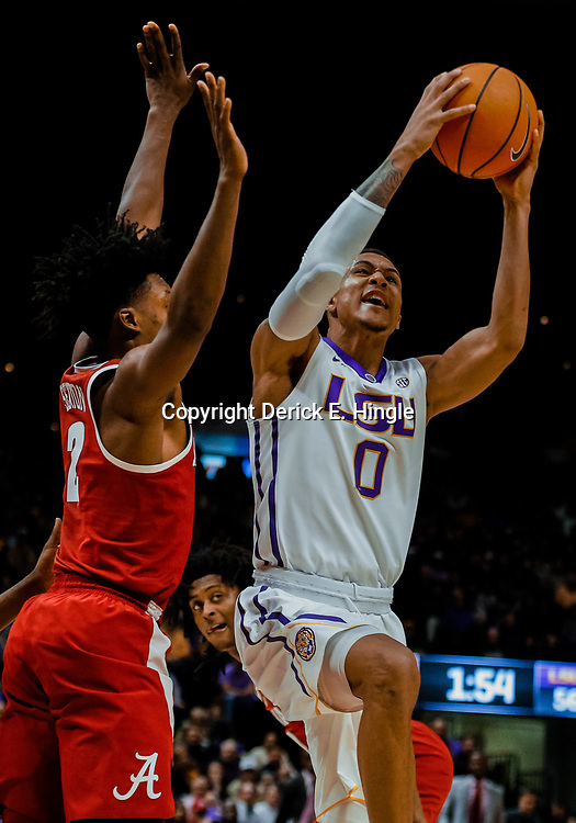 Jan 13, 2018; Baton Rouge, LA, USA; LSU Tigers guard Brandon Sampson (0) drives to the basket past Alabama Crimson Tide guard Collin Sexton (2) during the second half at the Pete Maravich Assembly Center. Alabama defeated LSU 74-66.  Mandatory Credit: Derick E. Hingle-USA TODAY Sports