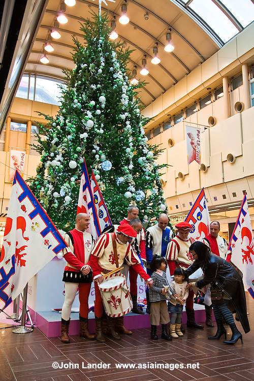 Yes, Christmas is celebrated in Japan but usually only as an excuse to have a party, a large dinner (almost never turkey) and  gift giving.  In short, it is the festive mood that attracts the Japanese who are oblivous to its original religious significance.  On the other hand there is no pretense about it in Japan - it is simply a commercial venture of gift shopping, admiring decorations and dinner party time.