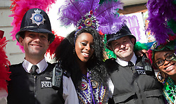 © Licensed to London News Pictures. 28/08/2011. London, UK. Notting Hill Carnival 2011 on Children's Day. Group: Sunshine International with officers from the Metropolitan Police. Photo credit: Bettina Strenske/LNP