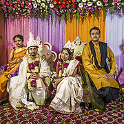 The couple are seated on an elevated platform and all the guests are invited to bless them, give their presents and have a picture taken together with the bride and groom. This is an exhausting process that could sometime take a couple of hours. Bengali wedding, Delhi 2008