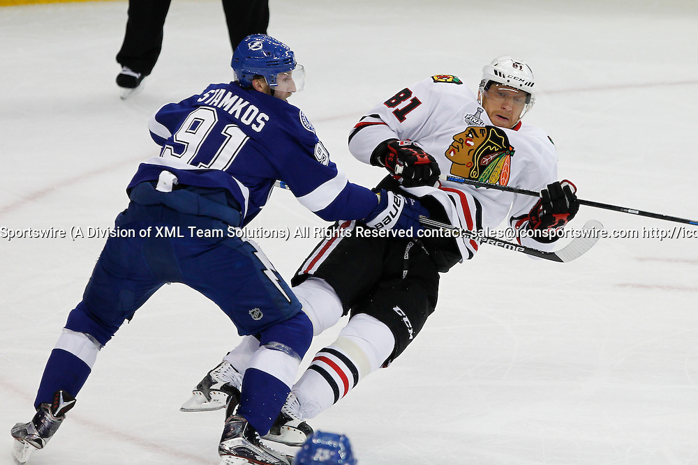 06 June 2015: Tampa Bay Lightning center Steven Stamkos (91) checks Chicago Blackhawks right wing Marian Hossa (81) in the 1st period of Game 2 of the Stanley Cup Finals between the Chicago Blackhawks and Tampa Bay Lightning at Amalie Arena in Tampa, FL.