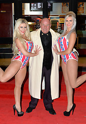 Pictured are Union Jack girls Roxanna (left) and Natalie (right) with Dave Courtney.<br /> London gangster Dave Courtney arrives on the red carpet for the film premiere of 'Full English Breakfast' that he stars in, at The Prince Charles Cinema, London, UK.<br /> Tuesday, 25th March 2014. Picture by Ben Stevens / i-Images