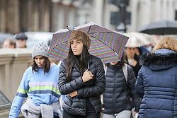 © Licensed to London News Pictures. 01/11/2019. London, UK. A woman shelters from the rain underneath an umbrella on a wet and milder November day in Westminster, London. Photo credit: Dinendra Haria/LNP