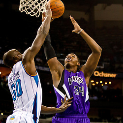 December 15, 2010; Sacramento Kings center Jason Thompson (34) shoots over New Orleans Hornets center Emeka Okafor (50) during the second half at the New Orleans Arena. The Hornets defeated the Kings 94-91. Mandatory Credit: Derick E. Hingle