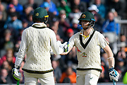 50 - Tim Paine of Australia celebrates scoring a half century and is congratulated by Steve Smith of Australia during the International Test Match 2019, fourth test, day two match between England and Australia at Old Trafford, Manchester, England on 5 September 2019.