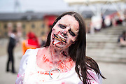 UNITED KINGDOM, London: 27 May 2016 A cosplay fan dresses as a zombie outside of the MCM London Comic Con held all this weekend at The ExCeL Centre. The comic convention will see an estimated 150,000 cosplay and comic fans flock to the exhibition. Rick Findler / Story Picture Agency
