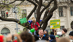 "29.11.2015, Innere Stadt, Wien, AUT, Globaler Marsch ""System Change, not Climate Change!"" anlässlich des ab morgen stattfindenden Klimagipfel ""COP21"" in Paris. im Bild Kinder sitzen auf einem Baum // children sitting on a tree during global climate march in austria according climate summit in paris in the inner city in Vienna, Austria on 2015/11/29 EXPA Pictures © 2015, PhotoCredit: EXPA/ Michael Gruber"