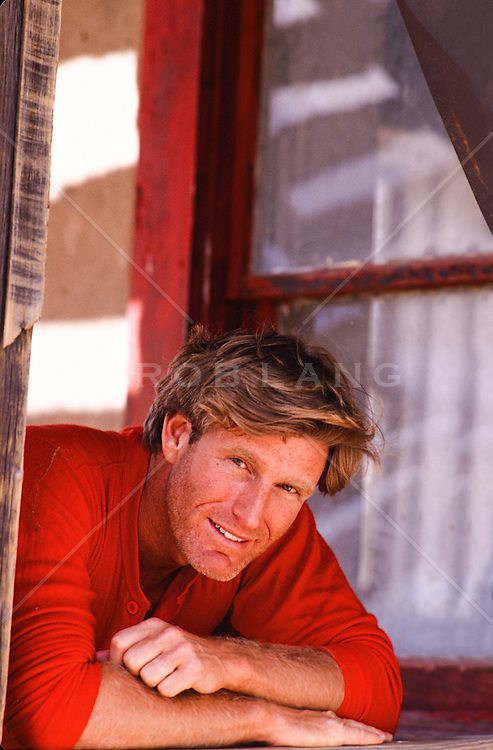 Portrait of an All American rugged man looking out a window