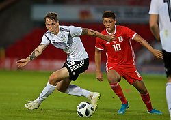WREXHAM, WALES - Tuesday, September 10, 2019: Germany's Adrian Fein (L) and Wales' Brennan Johnson during the UEFA Under-21 Championship Italy 2019 Qualifying Group 9 match between Wales and Germany at the Racecourse Ground. (Pic by David Rawcliffe/Propaganda)