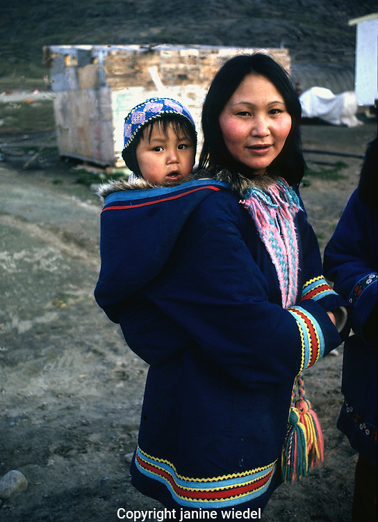 Inuit mother with child carried inside hood on Baffin island NWT.