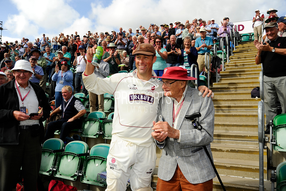 Marcus Trescothick of Somerset goes into the Marcus Trescothick Stand and embraces an elderly member while on a lap of honour after beating Middlesex to secure survival in Division 1 of the Specsavers County Champ Div 1 match between Somerset County Cricket Club and Middlesex County Cricket Club at the Cooper Associates County Ground, Taunton, United Kingdom on 28 September 2017. Photo by Graham Hunt.
