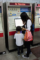 woman and child at ticket machine, Shanghai China