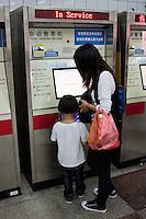 woman and child at ticket machine, Shanghai China