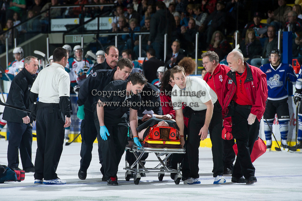 KELOWNA, CANADA - JANUARY 2: Dr. Mike Shepherd,  team physician, and Jeff Thorburn, athletic therapist of the Kelowna Rockets assist Khore Elliott, athletic therapist of the Victoria Royals and medical first responders as they tend to an injured Ben Walker #10 of the Victoria Royals after a collision with Royals' teammate #7 Tyler Stahl at the Kelowna Rockets on January 2, 2013 at Prospera Place in Kelowna, British Columbia, Canada (Photo by Marissa Baecker/Shoot the Breeze) *** Local Caption ***