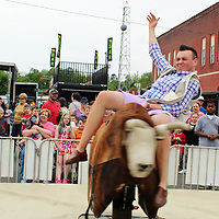 A rider tries to stay on Wild Willy, the mechanical bull.