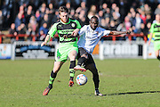 Bromley's Ali Fuseini and Forest Green's Sam Wedgbury tussle for the ball during the Vanarama National League match between Bromley FC and Forest Green Rovers at Hayes Lane, Bromley, United Kingdom on 28 March 2016. Photo by Shane Healey.