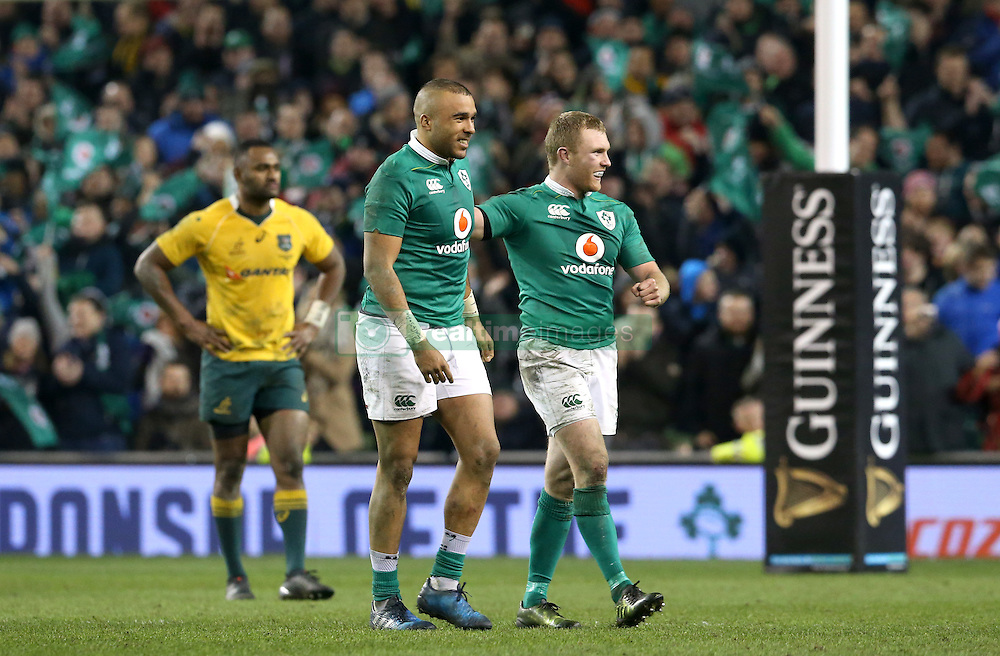 Ireland's Simon Zebo and Keith Earls (right) celebrate victory after the Autumn International match at the Aviva Stadium, Dublin.