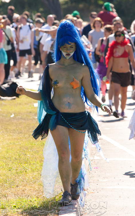 Unidentified scantily-clad woman in a blue wig skips through Golden Gate Park, at the 97th running of the Bay to Breakers 12K race, Sunday, May 18, 2008 in San Francisco. (Photo by D. Ross Cameron)