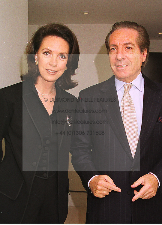 MR & MRS FRANCO ZANGRILLI he is the art dealer, at a party in London on 7th October 1998.MKO 23