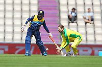 Cricket - 2019 ICC Cricket World Cup warm ups - Australia vs. Sri Lanka<br /> <br /> Steve Smith of Australia trys to catch a low ball whilst bowling during the cricket world cup warm up match at the Hampshire Bowl Southampton England<br /> <br /> COLORSPORT/SHAUN BOGGUST