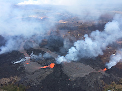 Handout photo taken on May 25, 2018 of KÄ«lauea Volcano — Lava Channel Merges. Fissures 6 (left) and 13 (right), with lava flows merging into one channel that flows into the ocean at the western-most entry. Note plume in distance at the ocean entries (top left). Photo is from an overflight at mid day. Photo by USGS via ABACAPRESS.COM