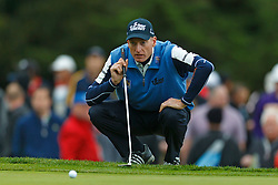 Feb 11, 2012; Pebble Beach CA, USA; Jim Furyk looks at the greens on the third hole during the third round of the AT&T Pebble Beach Pro-Am at Pebble Beach Golf Links. Mandatory Credit: Jason O. Watson-US PRESSWIRE
