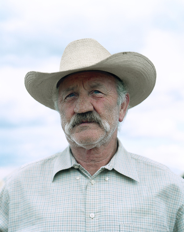 Outdoor portrait of a 60's male cowboy in New Mexico.
