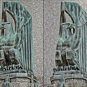 Art Deco American Eagles sculptures by Oscar Bach on both sides of the entrance to the Departments of Health Hospitals and Sanitation Building in lower Manhattan in New York City.<br />
