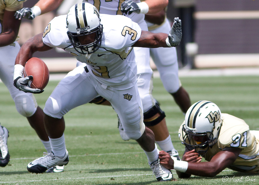 UCF wide receiver A.J. Guyton (3) pulls past Cornelius Whitehead (31) during the Spring Football Game at Bright House Stadium, Orlando, FL on April 16, 2011.  .