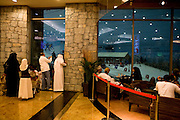 "Dubai, United Arab Emirates (UAE). January 30th 2009..Inside the Mall of the Emirates people watch ""Ski Dubai"" through the windows..It's the first indoor ski resort in the Middle East and offers an amazing snow setting to enjoy skiing, snowboarding and tobogganing, or just playing in the snow all year round."